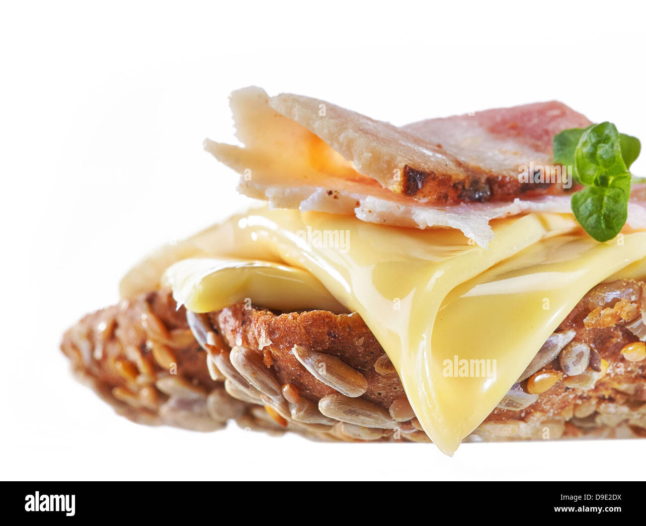Sandwich with melted cheese and bacon - Stock Image