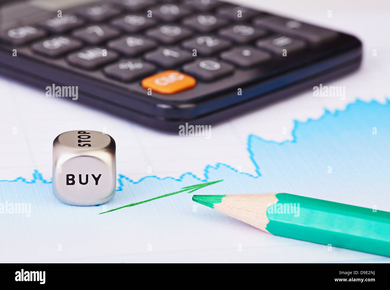 Uptrend financial chart of the stock market, green arrow, calculator, green pencil and dices cube with the word - Stock Image