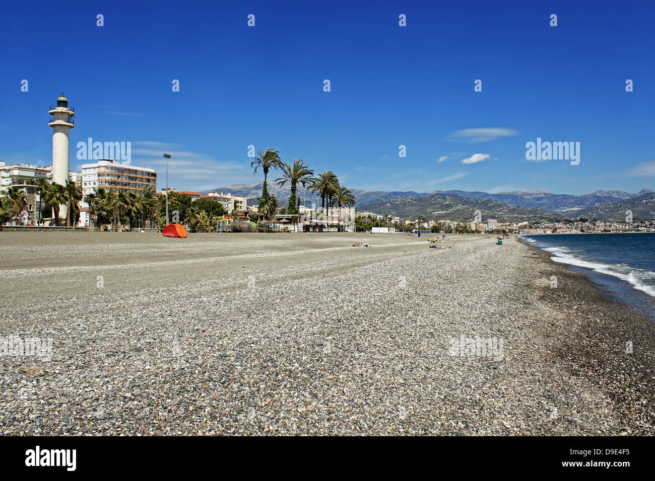 Lighthouse along the promenade at Torre del Mar's stony beach on the Costa Del Sol, Andalucia, Spain Stock Photo