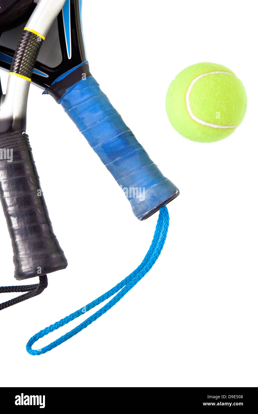 Padel tennis rackets and yellow ball isolated on white background - Stock Image
