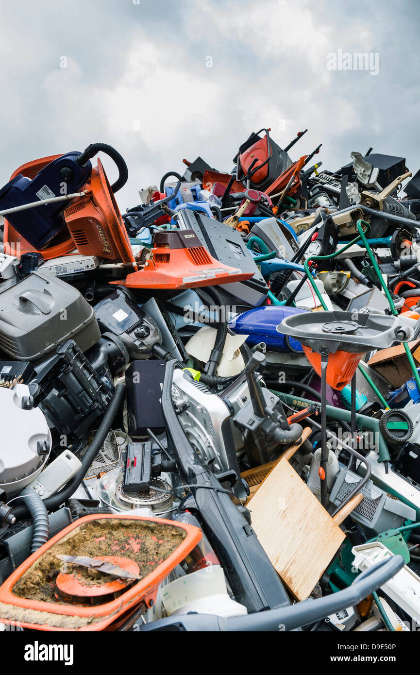 A pile of scrap scrapped discarded junked lawnmowers and  household electrical appliances awaiting recycling, UK - Stock Image
