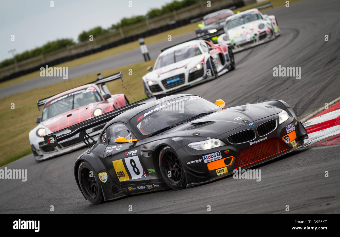 Various British GT cars going through Murray's corner - Stock Image