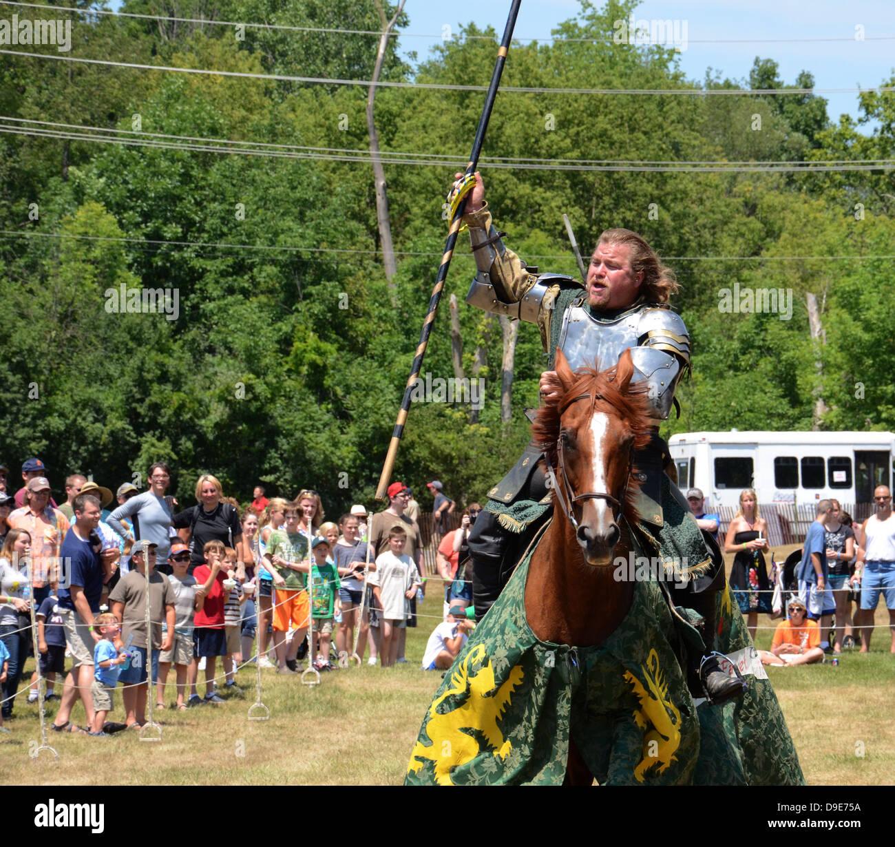 SALINE, MI - JULY 14: Victorious jouster at the Saline Celtic Festival July 14, 2012 in Saline, MI. Stock Photo