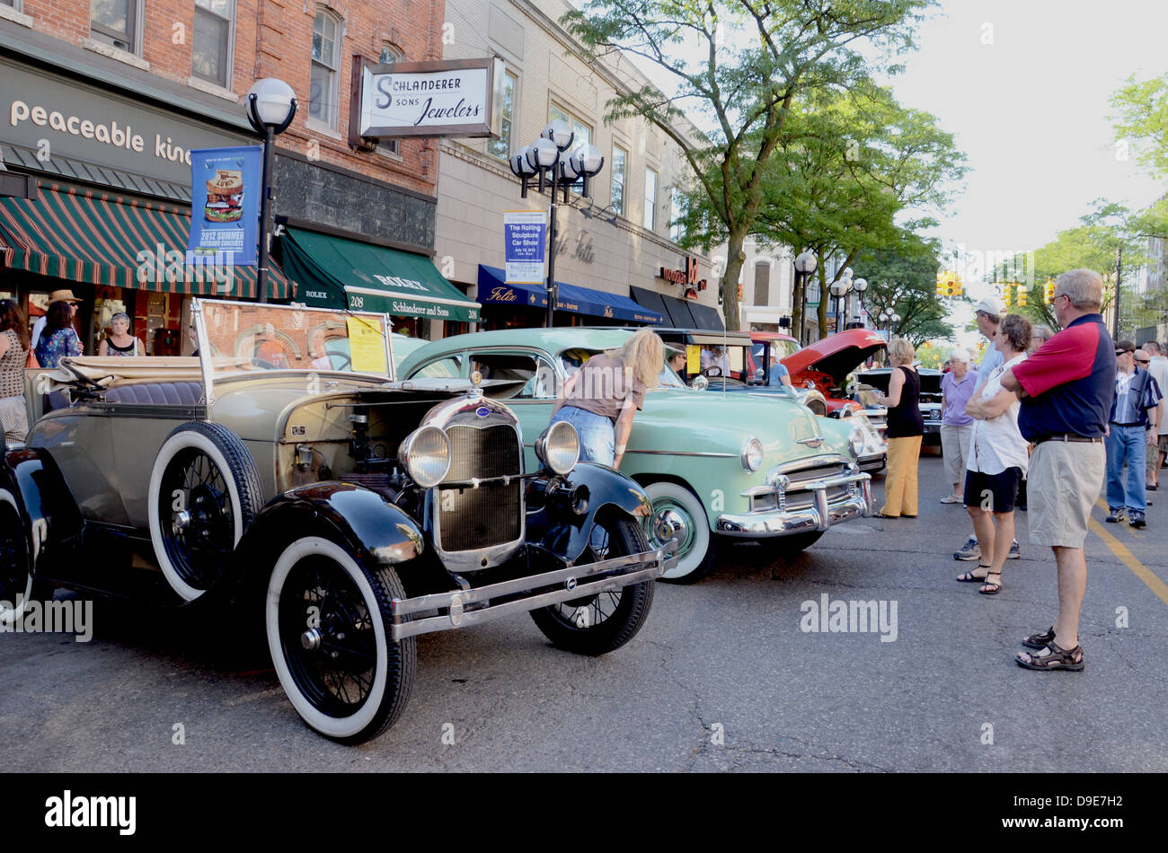 1928 Ford Model A and 1950 Chevrolet 2d Deluxe at the Rolling Sculpture car show July 13, 2012 in Ann Arbor, Michigan - Stock Image
