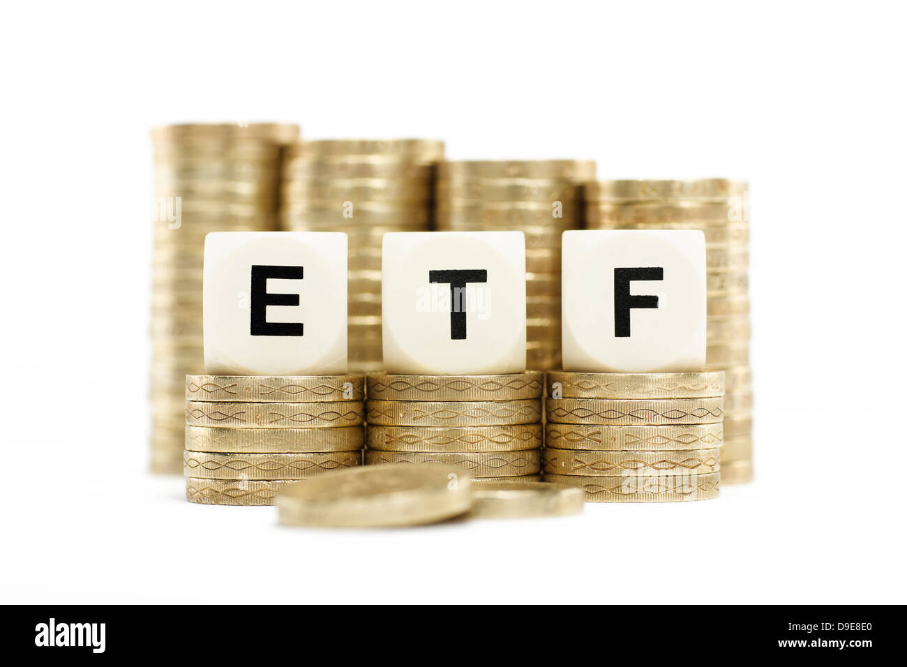 ETF (Exchange Traded Fund) on gold coins with white background Stock Photo