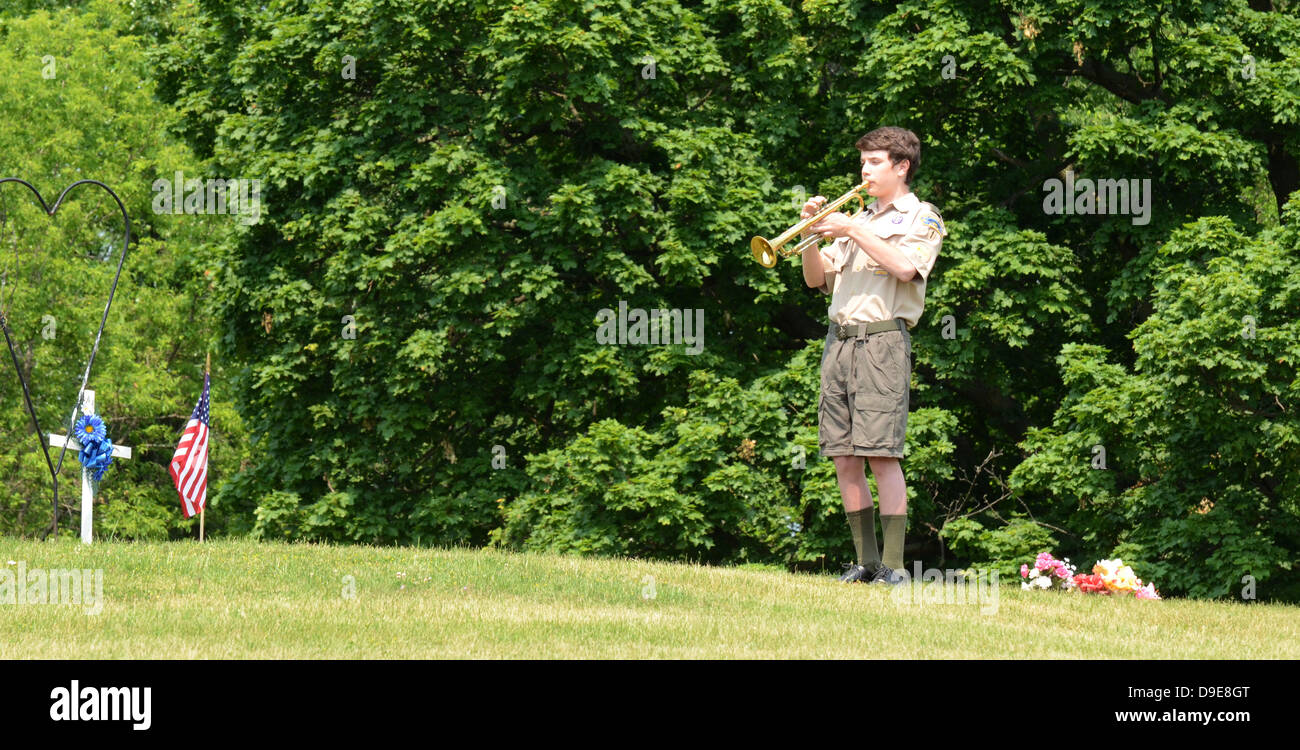 Boy scout playing taps at the annual Memorial Day observance on May 27, 2012 at Arborcrest Memorial Park in Ann - Stock Image
