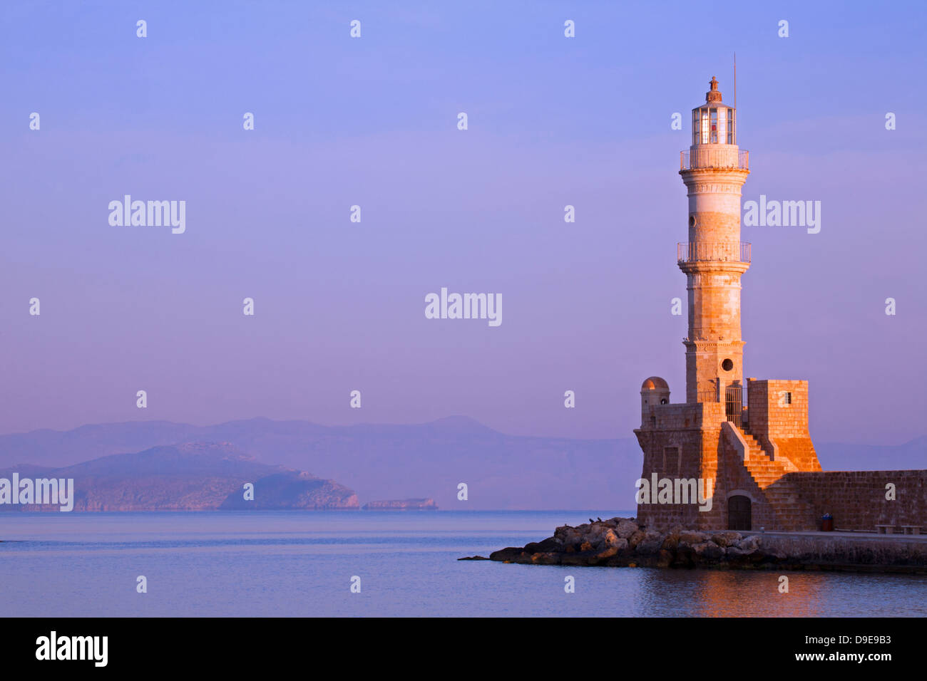 Chania's centuries-old lighthouse in Venetian Harbour in early morning Stock Photo