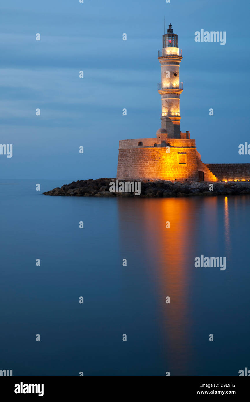Chania's centuries old lighthouse in Venetian Harbour at twilight Stock Photo
