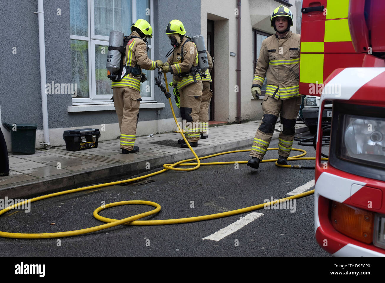 Emergency services (fire brigade) attending a kitchen fire in a house, Aberystwyth UK - Stock Image