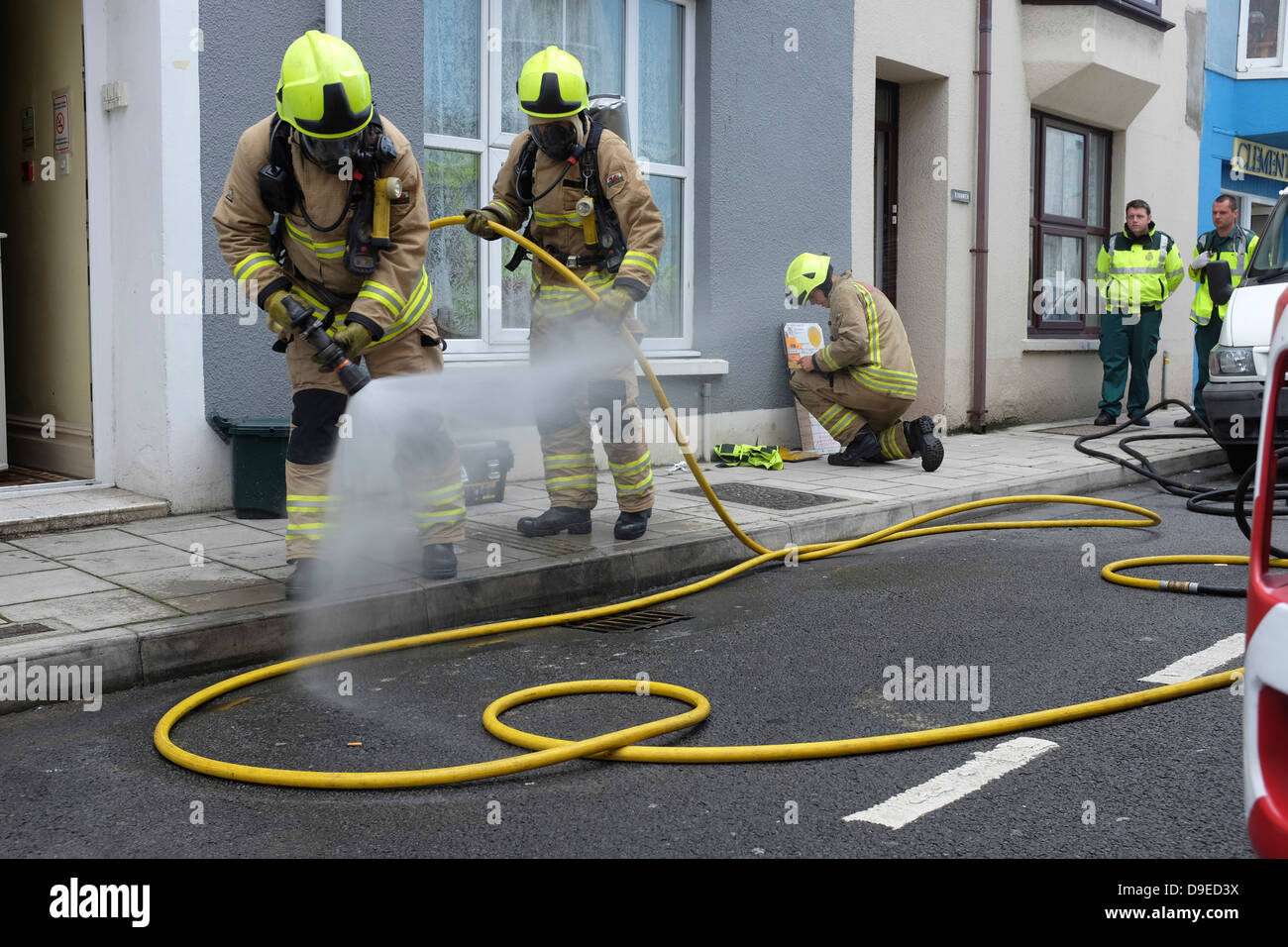 999 Emergency services (firebrigade, ambulance and police) attending a kitchen fire in a student house Aberystwyth - Stock Image