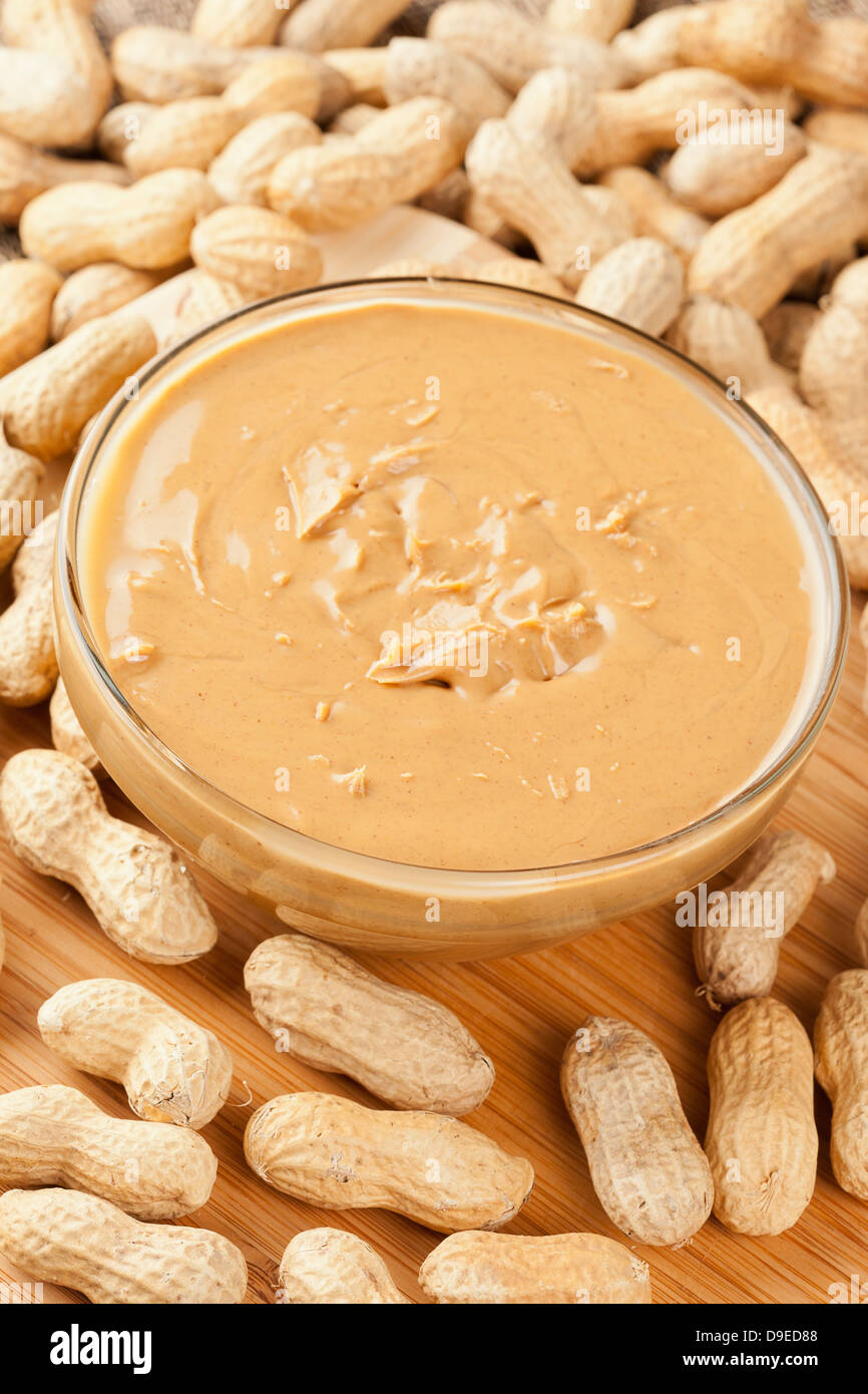 Creamy Brown Peanut Butter on a background - Stock Image
