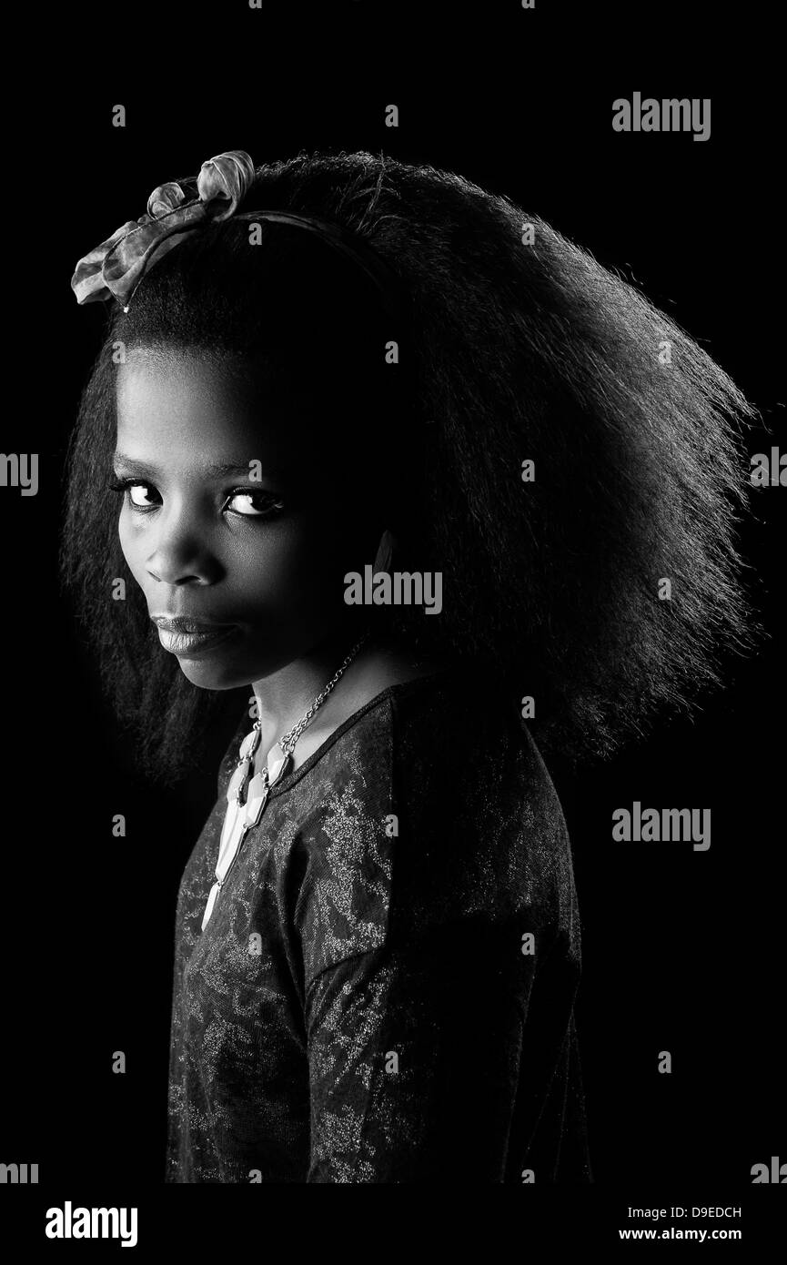 African black woman with big afro and necklace not smiling low key black white portrait south african girl xhosa fashion