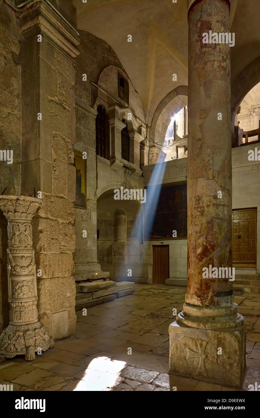 Sunbeam in Church of Holy Sepulchre on Golgotha in Jerusalem, Israel - Stock Image