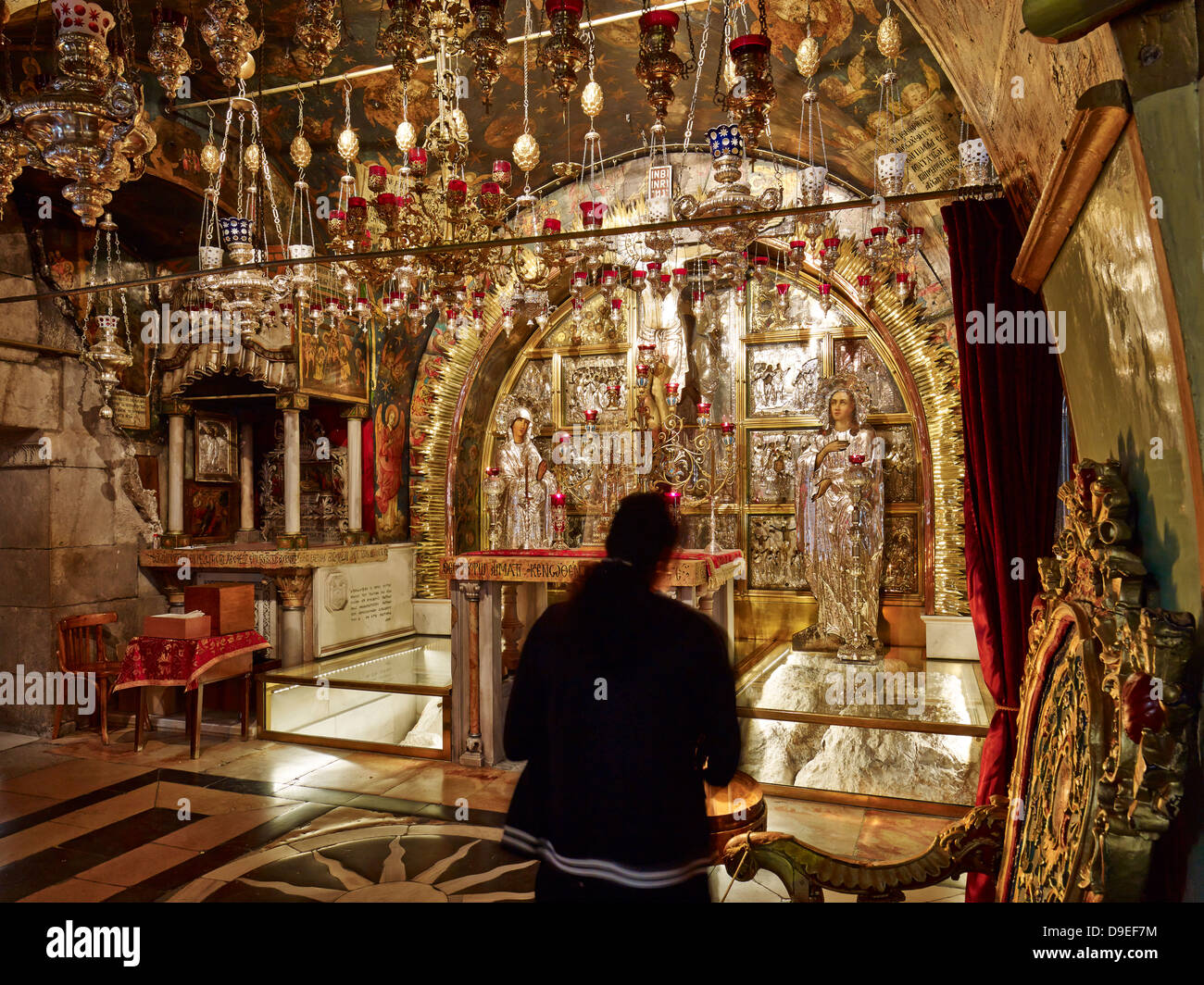Crucifixion altar in the Church of Holy Sepulchre on Golgotha in Jerusalem, Israel - Stock Image