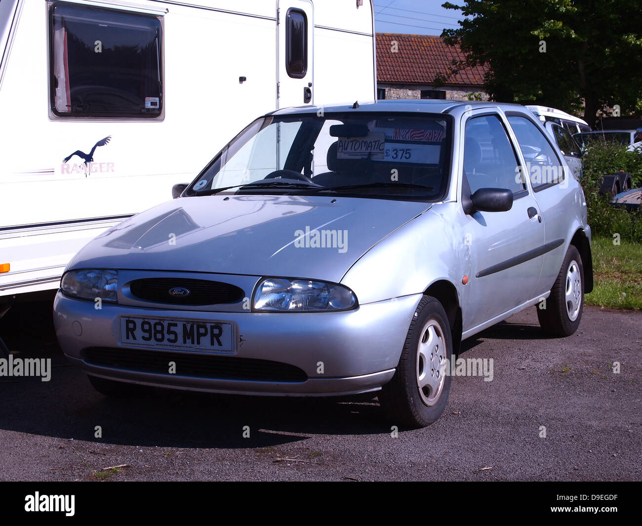 Small old Silver Ford Fiesta, up for sale on a garage forecourt, as ...
