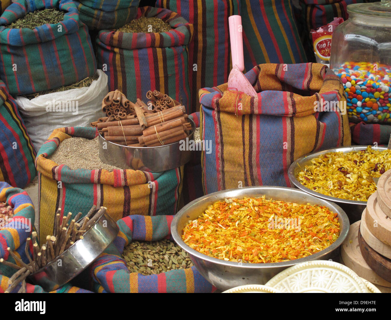 acco acre israel shuk market spices stripes bags - Stock Image