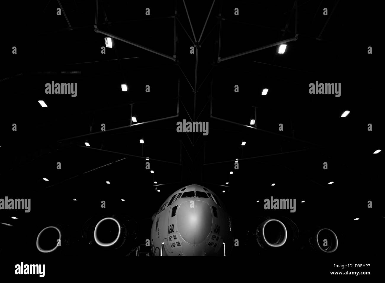 A C-17 Globemaster III sits in a hangar at McChord Field Air Force Base, Washington. - Stock Image