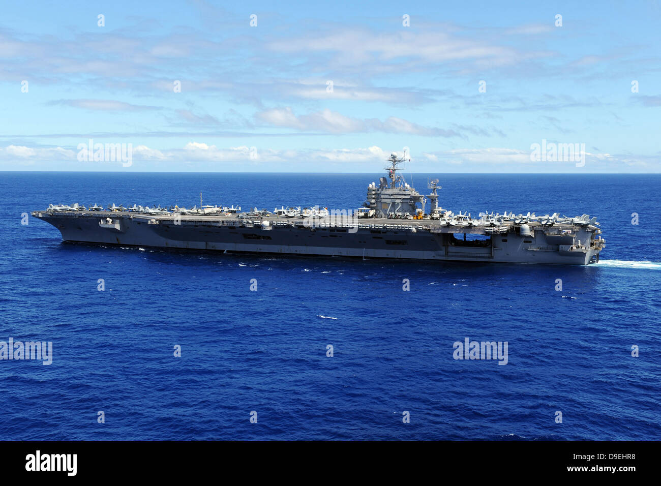 The aircraft carrier USS Abraham Lincoln transits across the Pacific Ocean - Stock Image