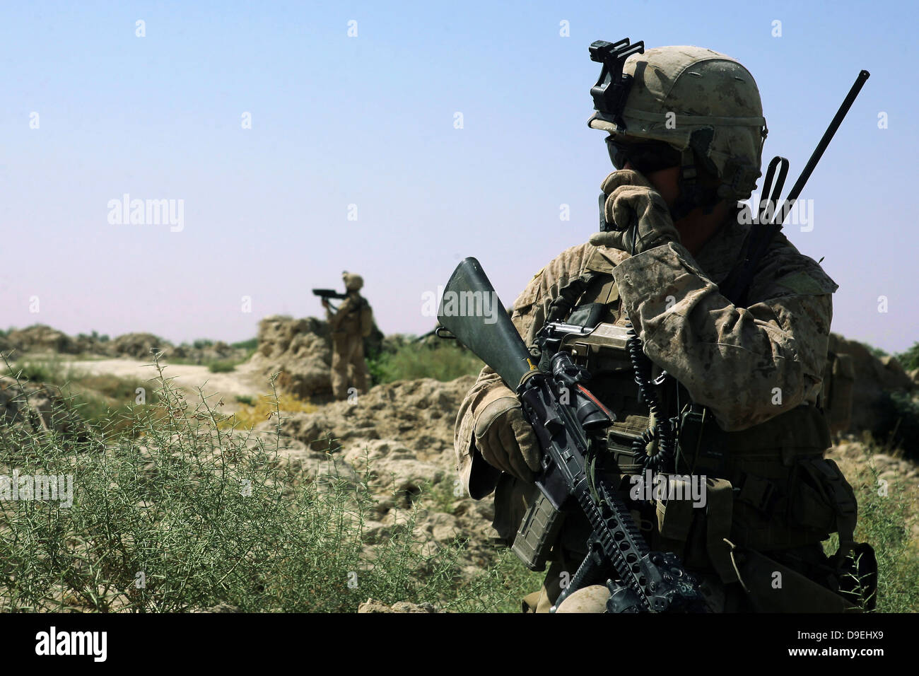 July 27, 2009 - U.S. Marine uses a radio during a security patrol in the Helmand province of Afghanistan. - Stock Image