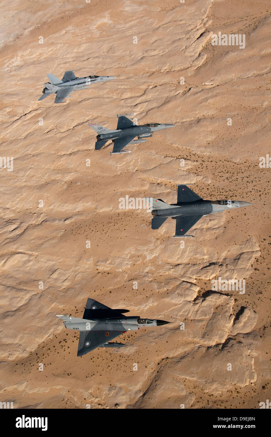 Military fighter jets fly in formation over Jordan. - Stock Image