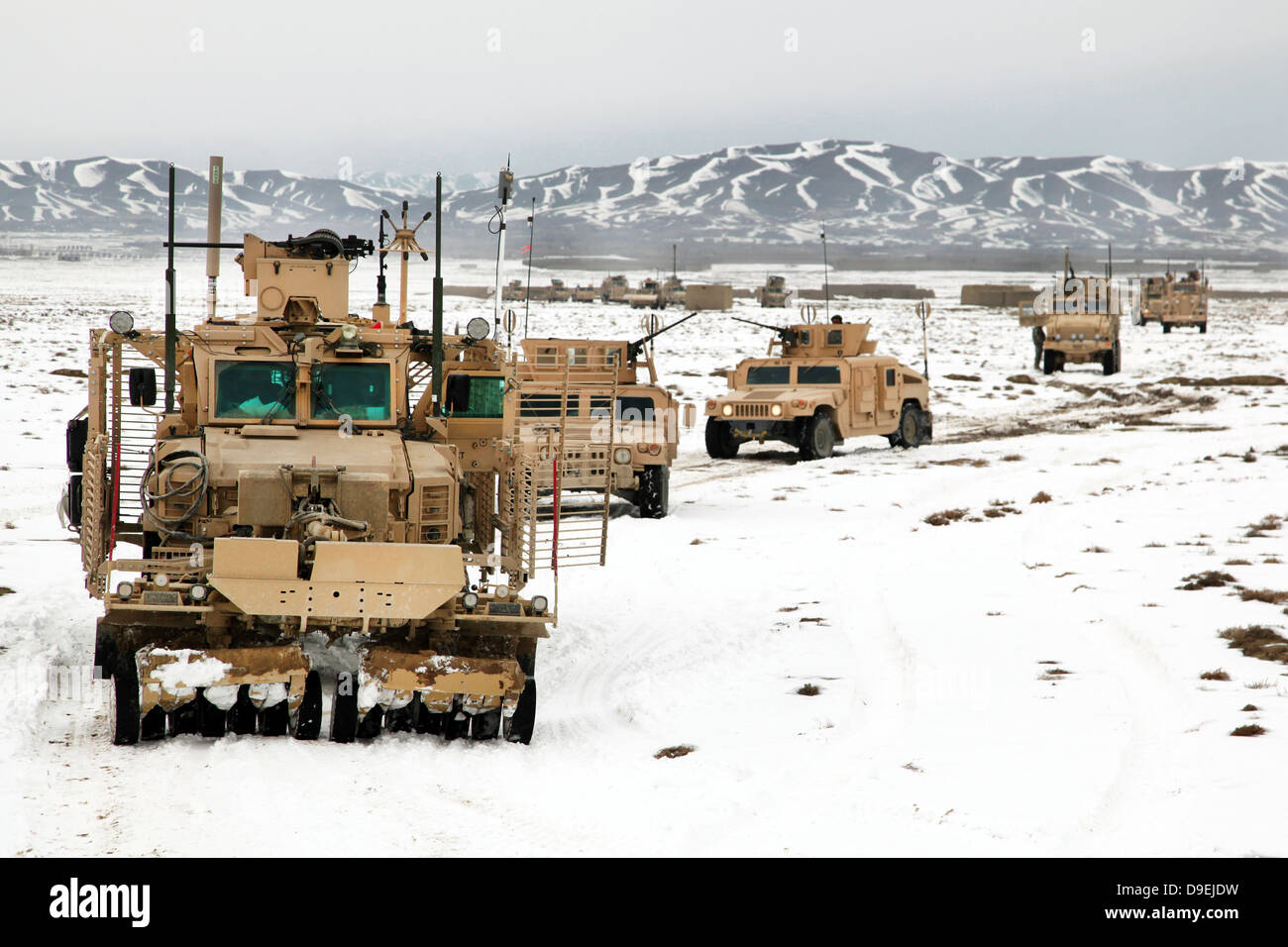 A convoy of vehicles during a route clearing procedure in Afghanistan. - Stock Image
