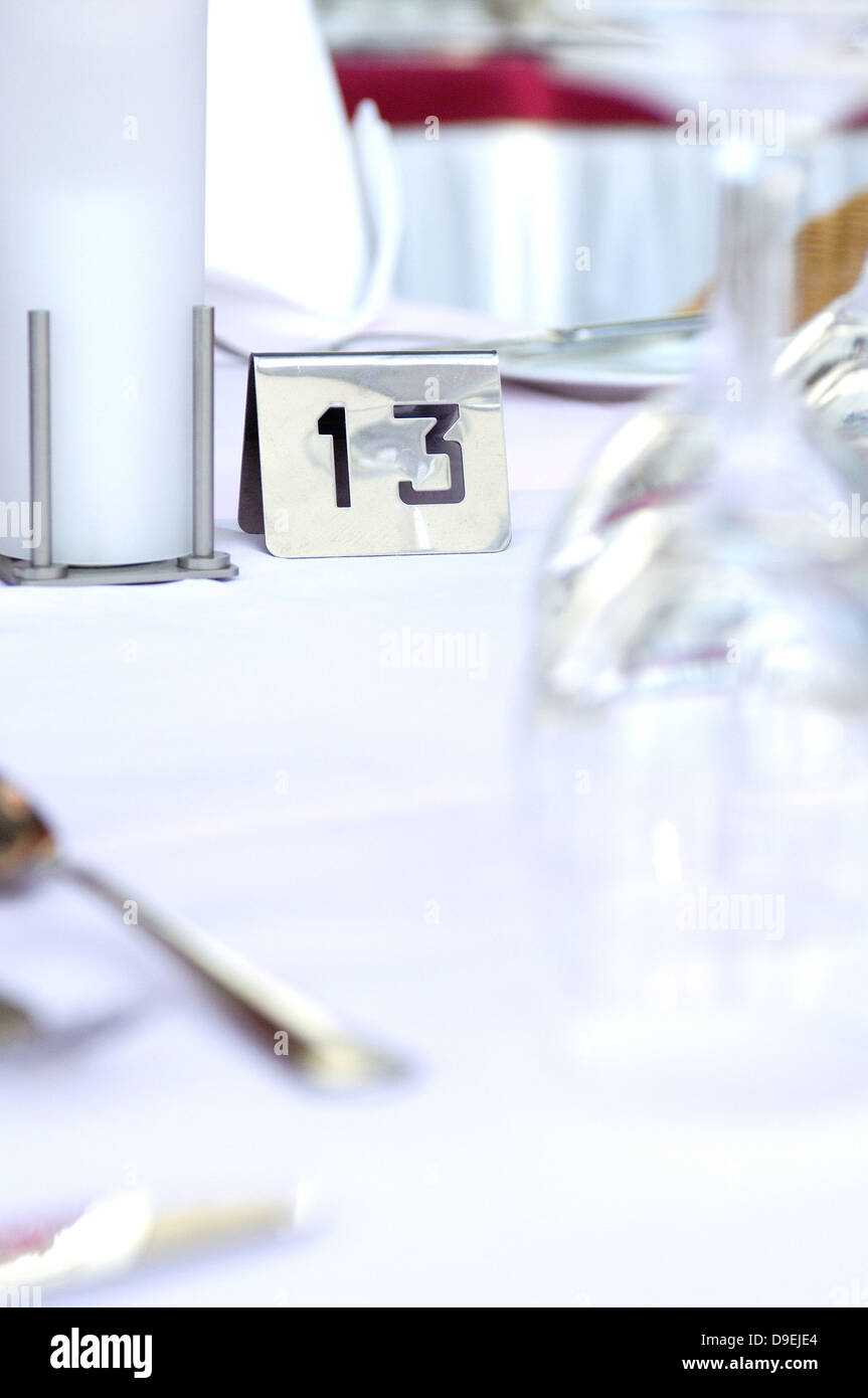 Covered hotel table with numbering - Stock Image