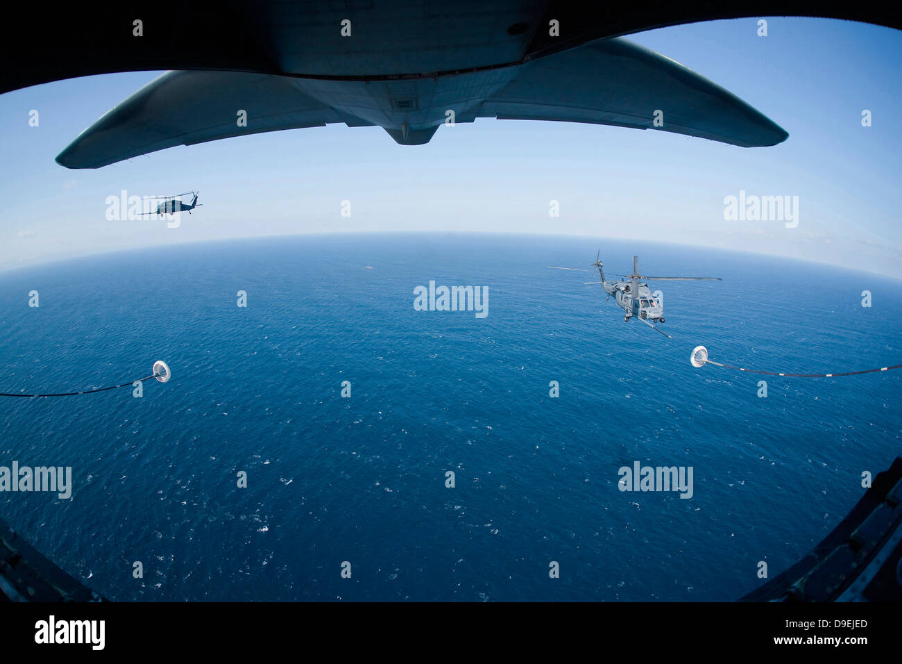 March 18, 2011 - An MC-130P Combat Shadow crew prepares to refuel two HH-60G Pave Hawk helicopters above the Pacific - Stock Image