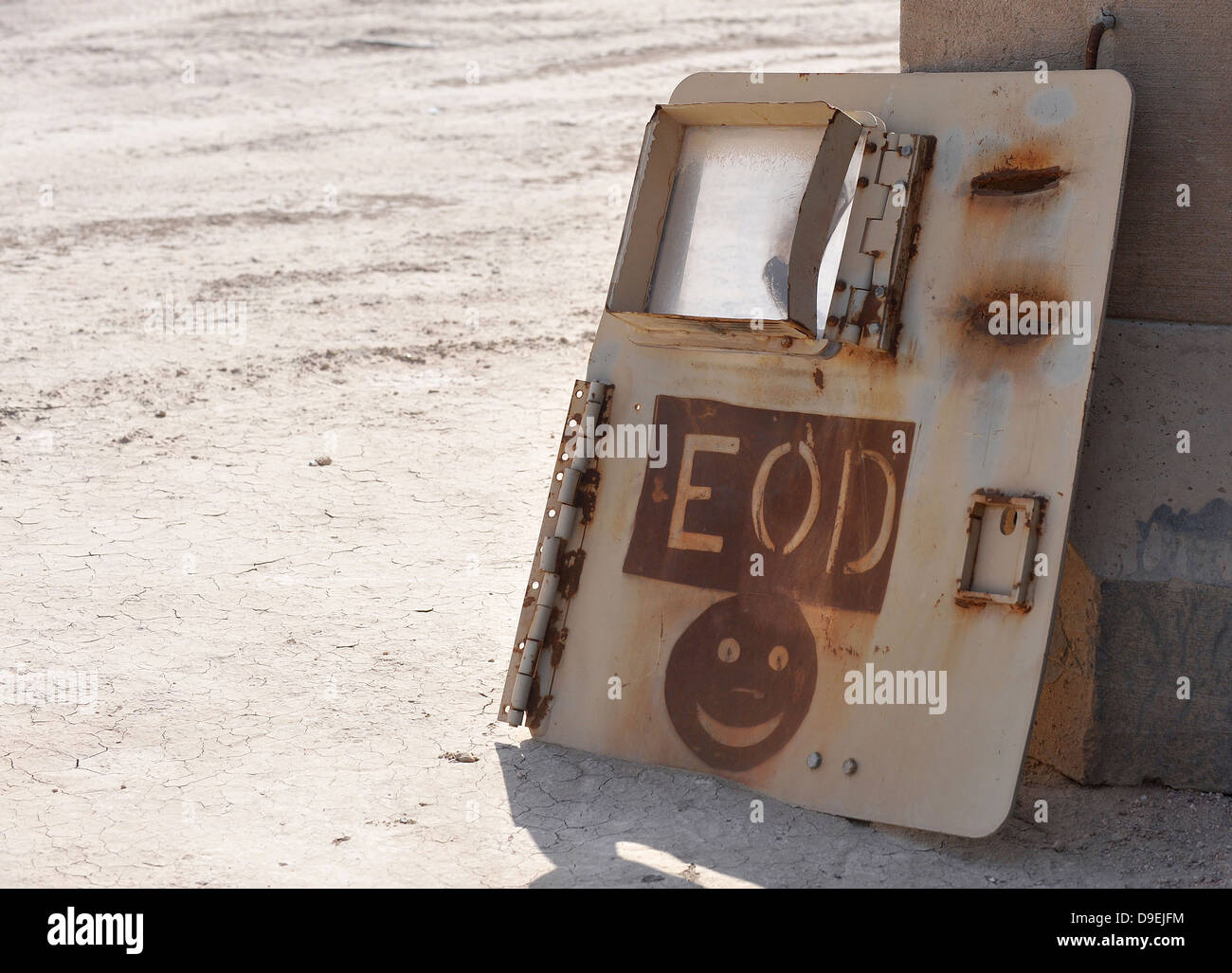 An Explosive Ordnance Disposal logo is painted on an old vehicle door at one of the ranges at Ali Air Base, Iraq. - Stock Image