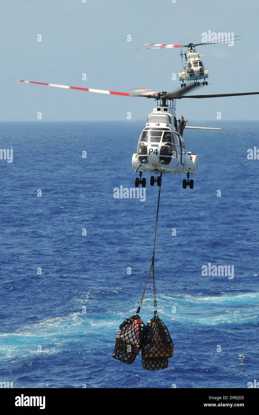 Two SA-330 Puma helicopters deliver pallets. - Stock Image