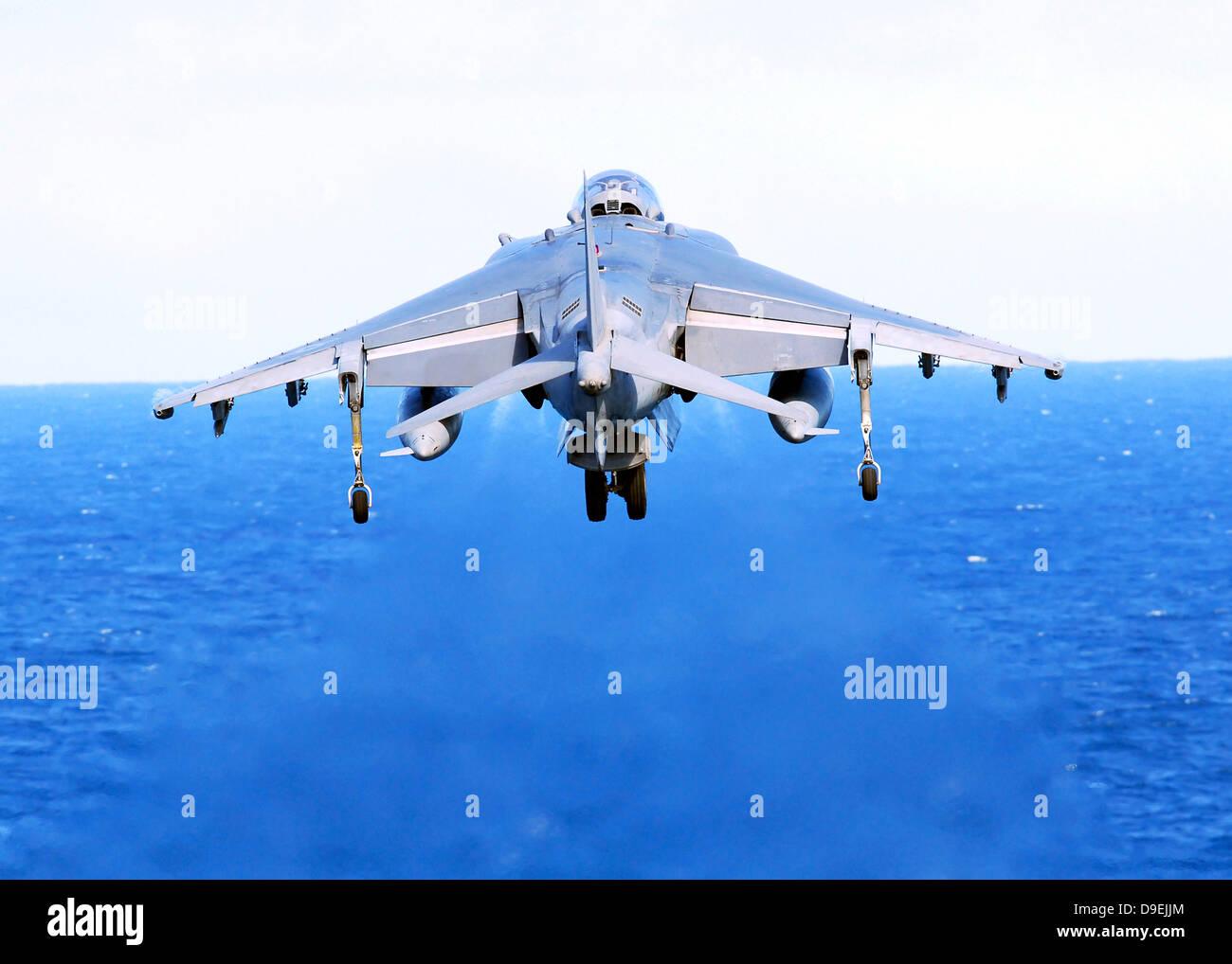 An AV-8B Harrier jet launches off the flight deck of USS Peleliu. Stock Photo