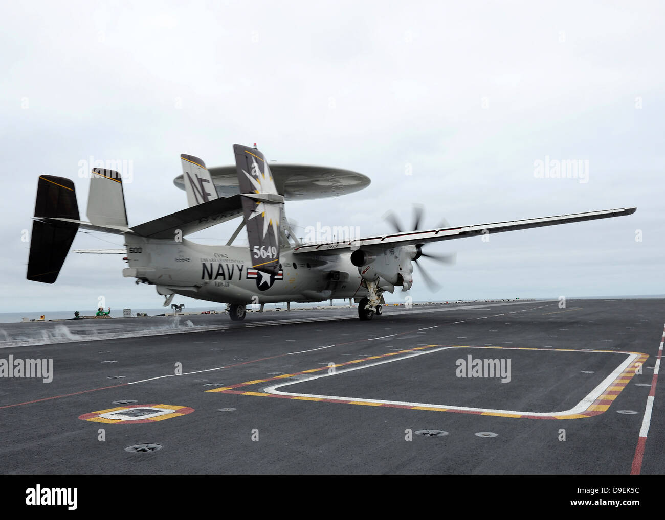 An E-2C Hawkeye launches off the flight deck of USS Abraham Lincoln. - Stock Image