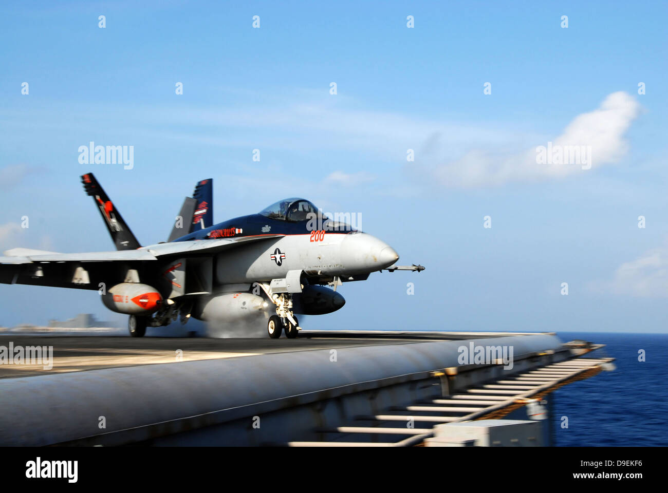 South China Sea, August 10, 2011 - An F/A-18E Super Hornet launches from the aircraft carrier USS Ronald Reagan. - Stock Image