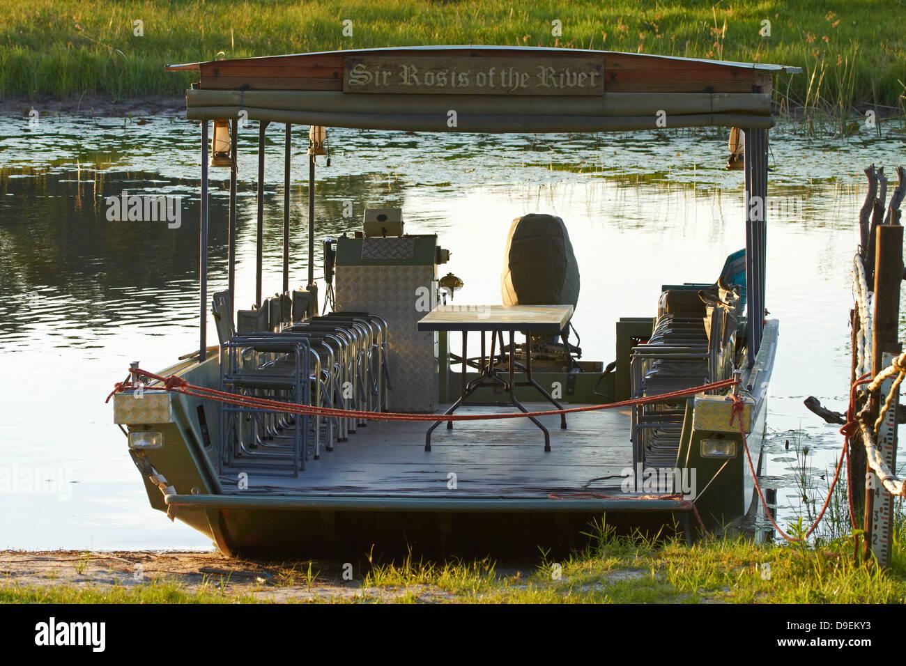 'Sir Rosis of the River' boat on banks of Thamalakane River, Okavango River Lodge, Maun, Okavango Delta, - Stock Image