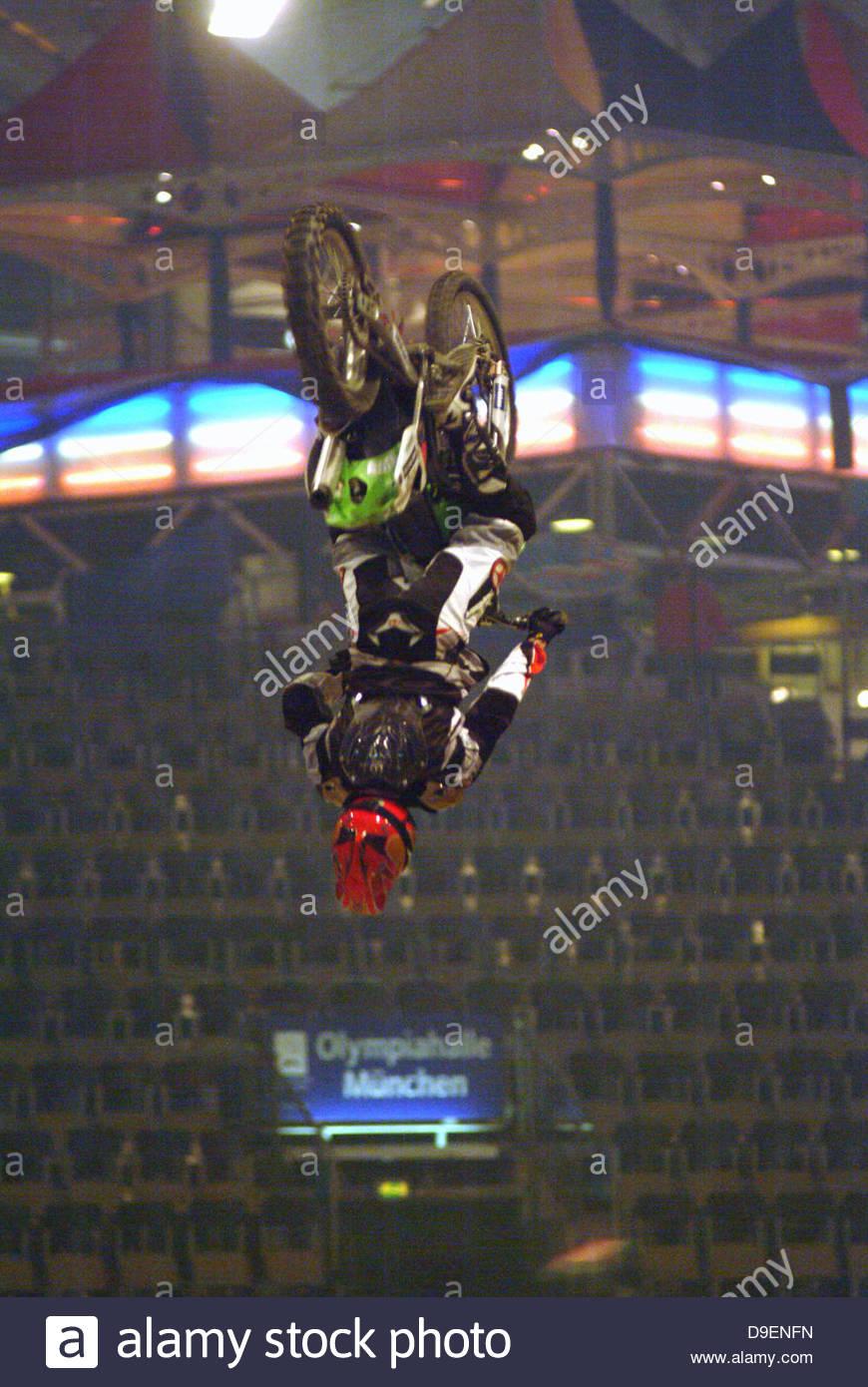 bike crash helmet daredevil down entertainment indoors inside jumping jumps male man motorbike motorcycle rider - Stock Image