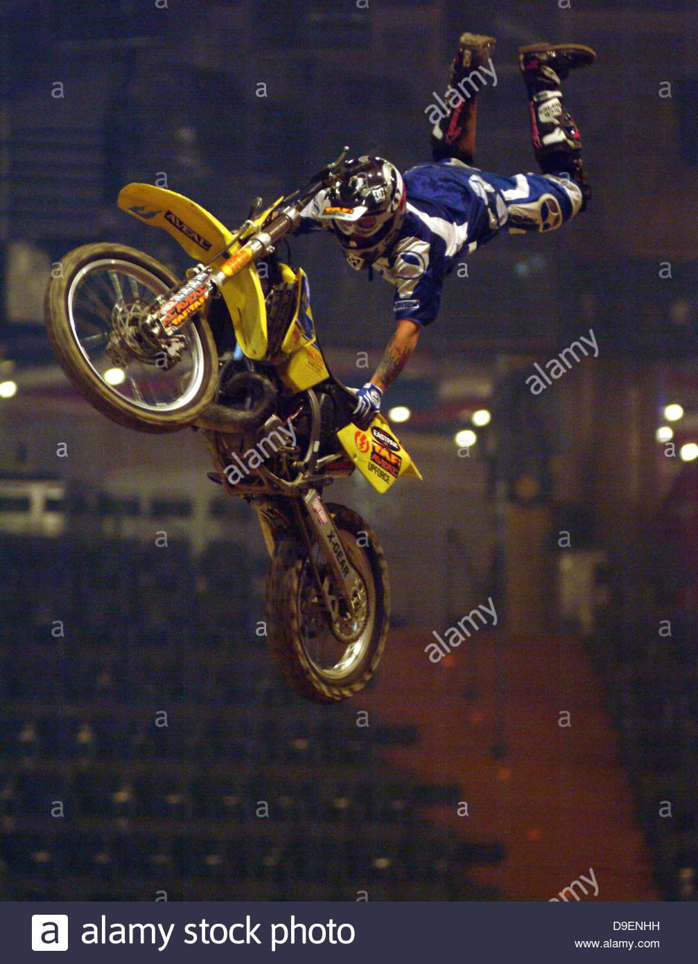 action adult bike crash helmet daredevil display exciting jumping jumps leaped leaps male man midair motorbike motorcycle - Stock Image