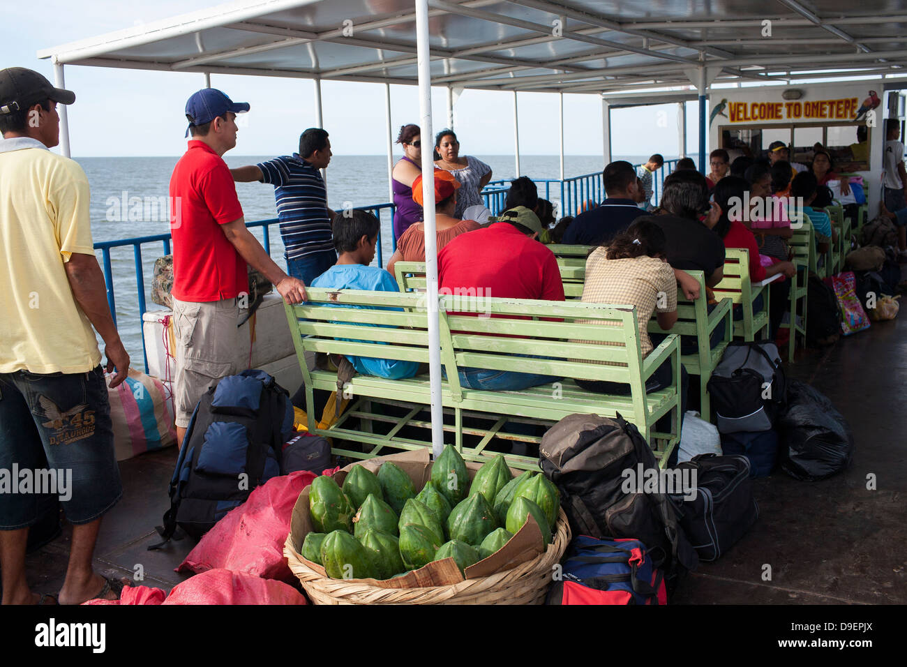 Passengers on the deck of the Rivas to Moyogalpa ferry on Ometepe in the middle of Lake Nicaragua Stock Photo