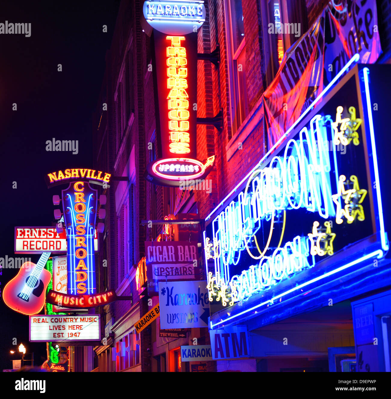 Neon signs of bars on Broadway in Nashville, Tennessee. - Stock Image