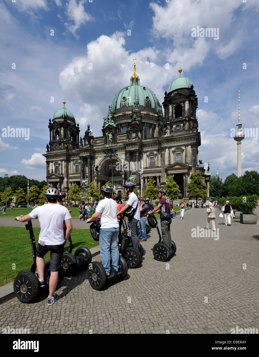 Town guidance for tourists with Segways, before Berlin cathedral in the pleasure garden, UNESCO world cultural heritage, - Stock Image