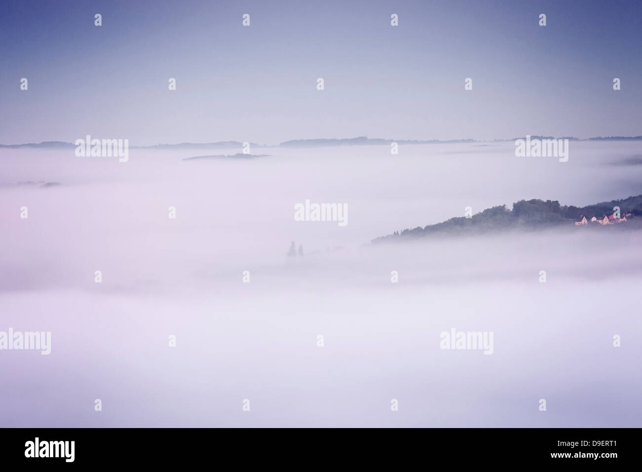 Domme Aquitaine France Early Morning Cloud Cover - the medieval bastide of Domme, covered by early morning mist - Stock Image