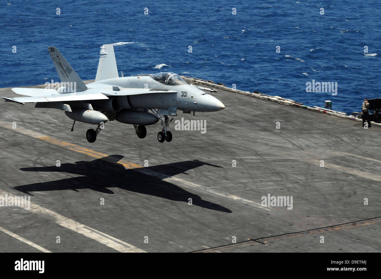 South China Sea, August 10, 2011 - An F/A-18C Hornet lands aboard the aircraft carrier USS Ronald Reagan. - Stock Image