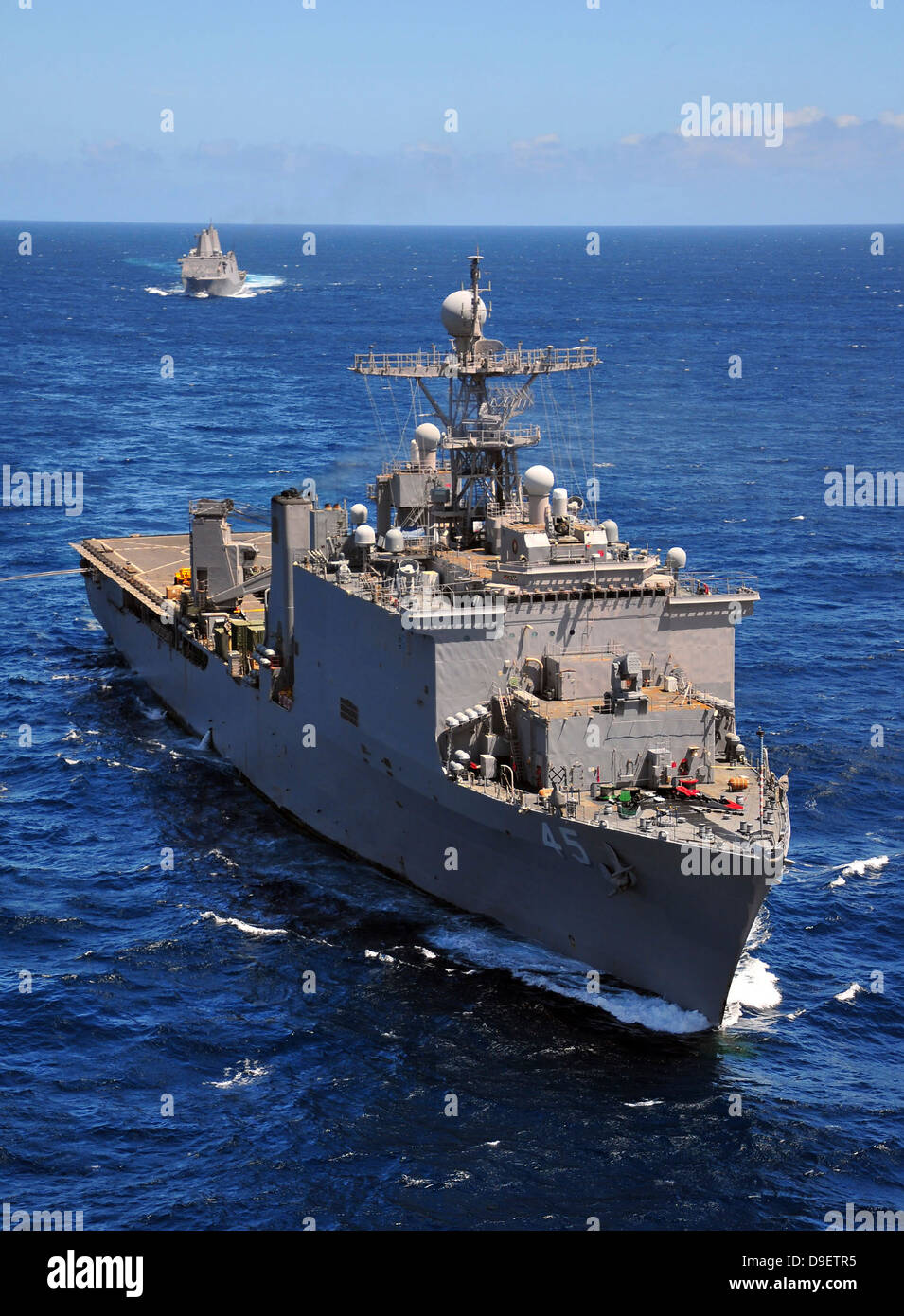 USS Comstock leads a convoy of ships in the Indian Ocean. - Stock Image