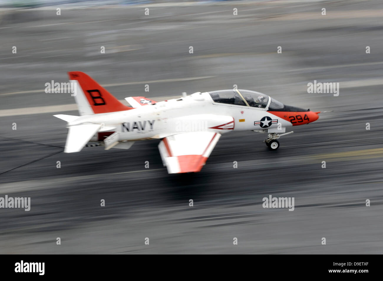 A T-45C Goshawk training aircraft makes an arrested landing. - Stock Image