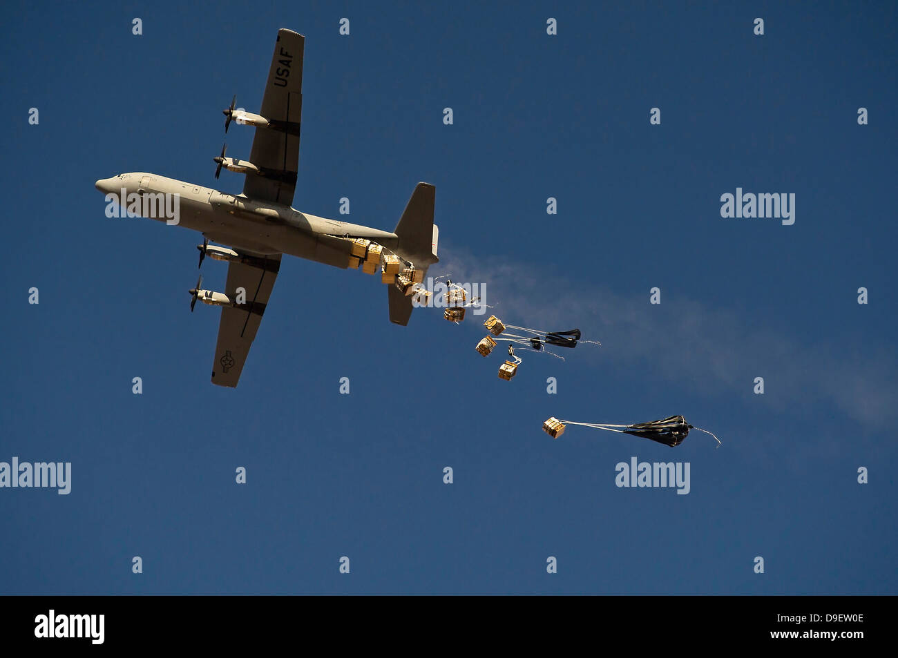 A U. S. Air Force C-130 Hercules airdrops 20 bundles over Afghanistan. - Stock Image