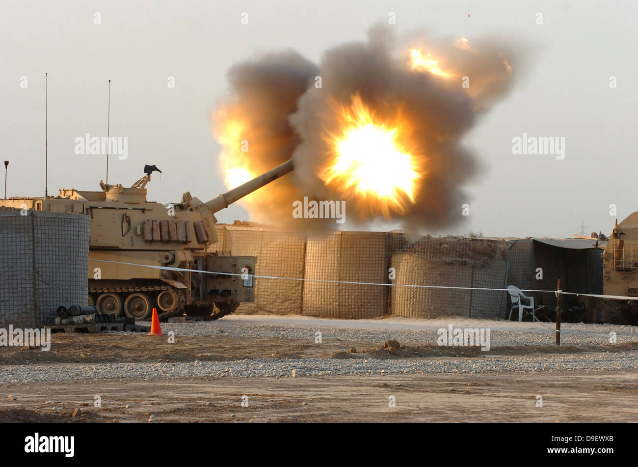 Soldiers fire the howitzers on their M109A6 Paladins. - Stock Image