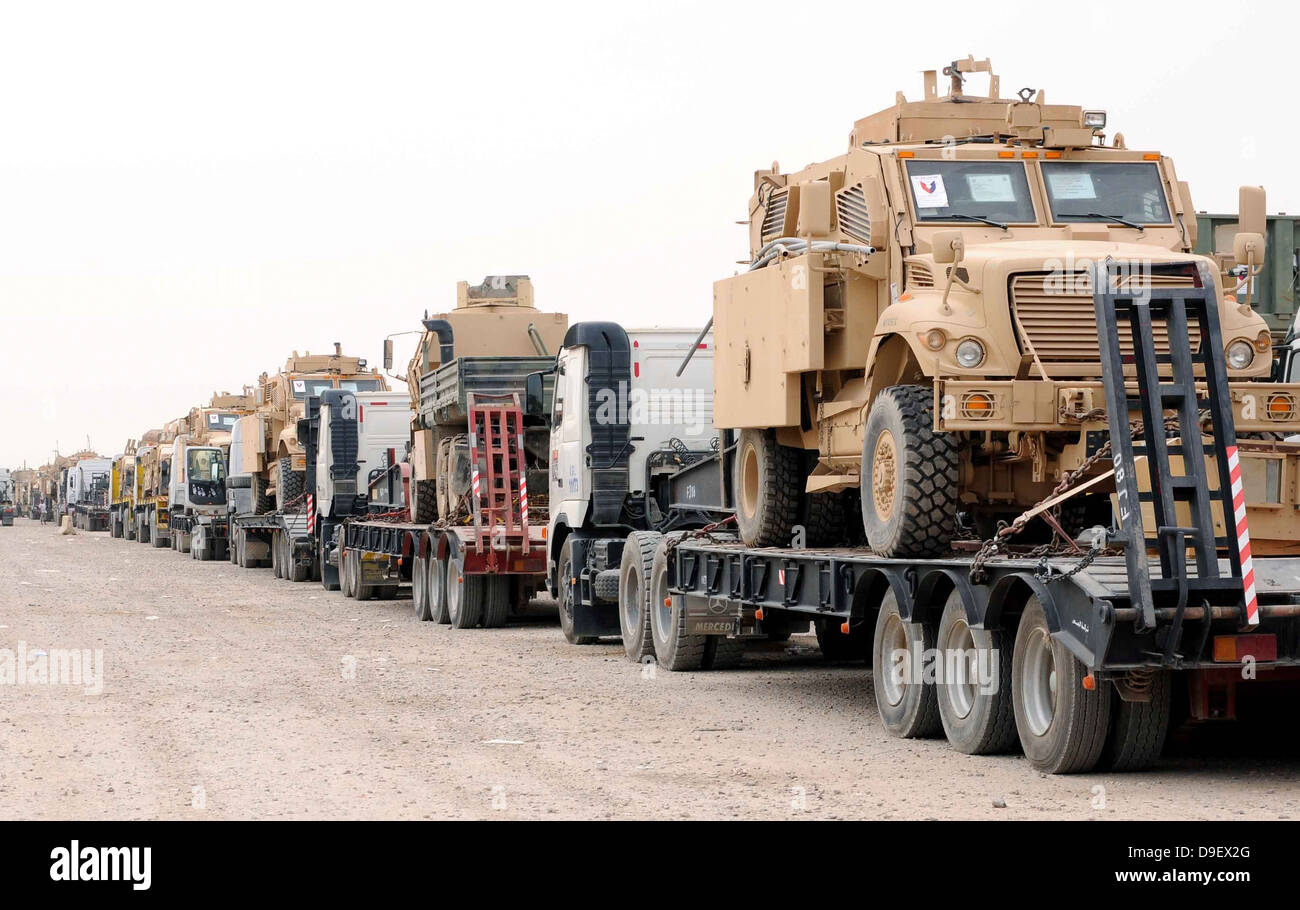 A convoy of Mine-Resistant Ambush Protected vehicles ready for departure - Stock Image