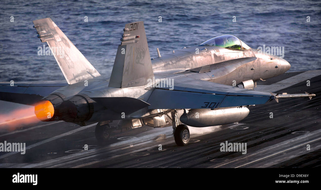 Arabian Sea, April 25, 2011 - An F/A-18C Hornet launches from the Nimitz-class aircraft carrier USS Carl Vinson. - Stock Image