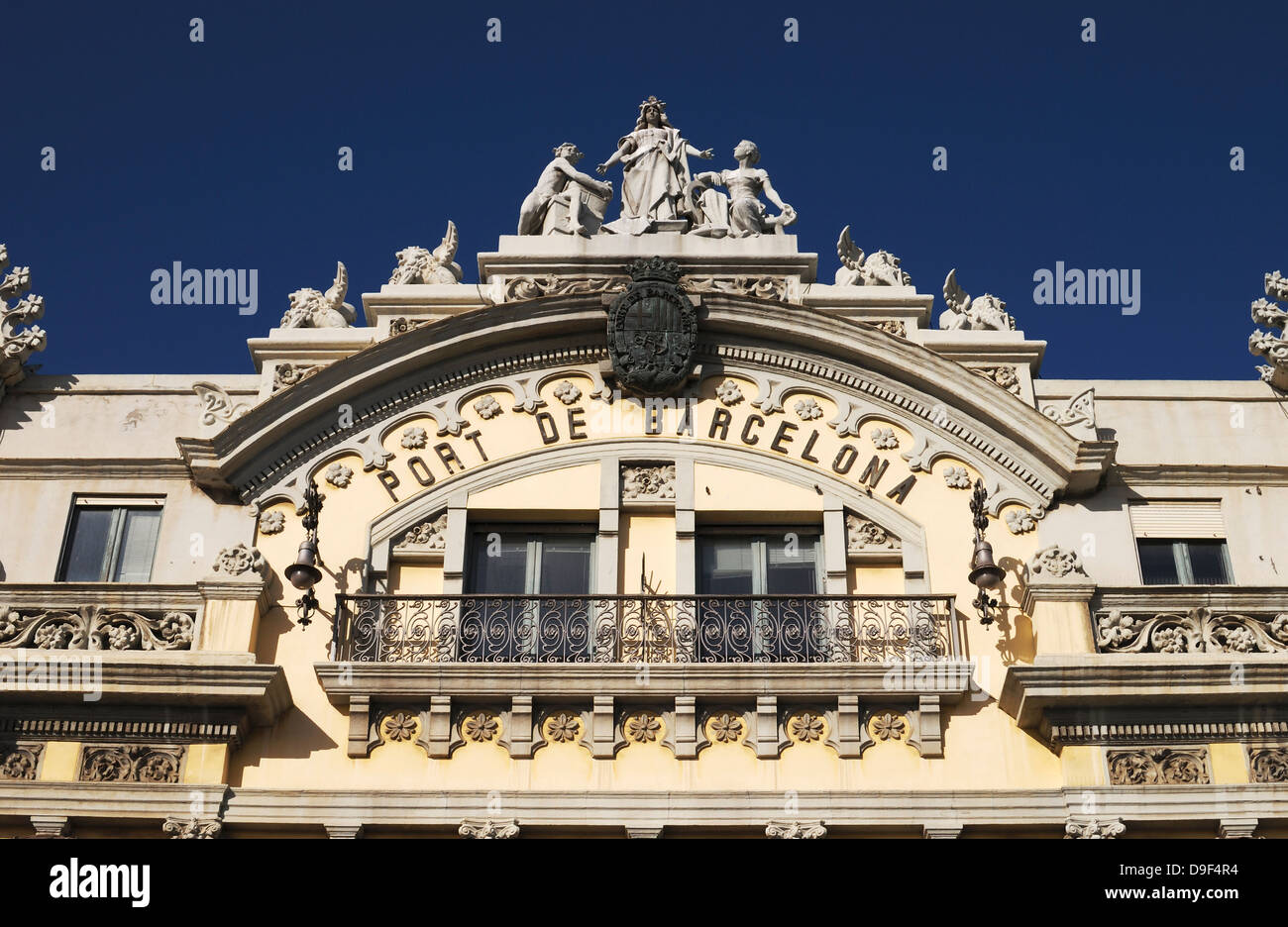 Traditional old Port Authority building by harbour at Barcelona. Catalonia. Spain. Detail above main doorway. - Stock Image