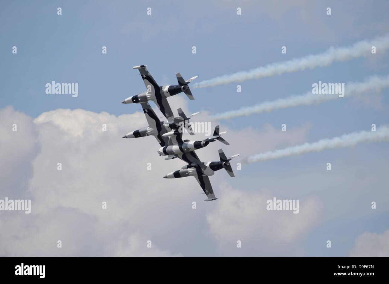 The Black Diamond Jet Team fly in diamond formation. - Stock Image