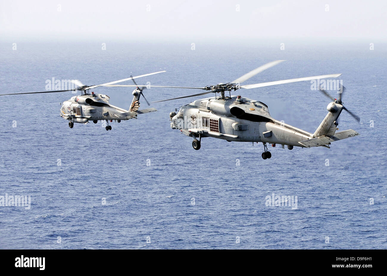 January 5, 2012 - An airborne change of command in the sky over the South China Sea. - Stock Image