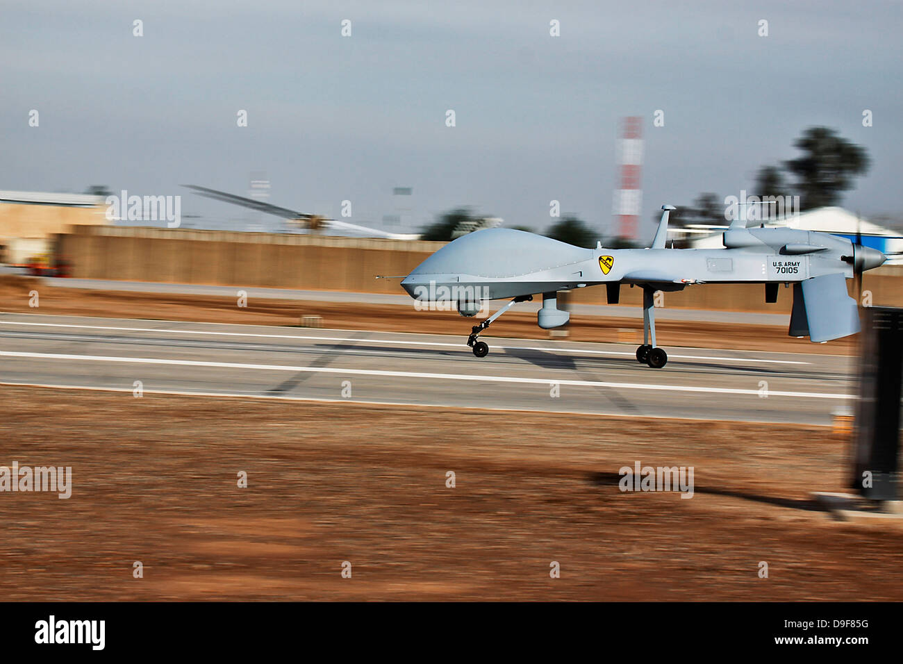 January 11, 2010 - An MQ-1C Sky Warrior unmanned aerial vehicle lands at Camp Taji, Iraq. - Stock Image